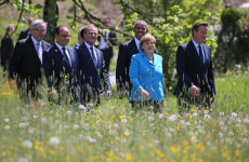 G7 leaders, led by German PM Angela Merkel (in blue) vowed this week to achieve aggressive cuts to global carbon emissions, although their plan was a bit lacking on details. [Image Source: EPA]