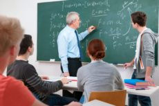 15134543 - teacher with a group of high school students in classroom