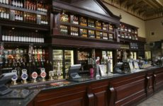 12468974 - edinburgh, uk - july 24, 2010: inside view of a public house, known as pub, for drinking and socializing, is the focal point of the community, pub business, now about 53,500 pubs in the uk, has been declining every year.
