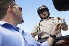 18833633 - man handing a police officer her license