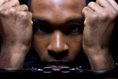 31088896 - close up portrait of hand cuffed black man