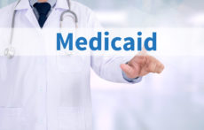 60088810 - medicaid medicine doctor working with computer interface as medical