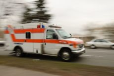 6620467 - a motion blur of an ambulance driving down a street.