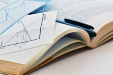 49211917 - closeup of an open economic textbook and chart