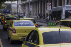 Rio de Janeiro, April 1, 2016: Hundreds of taxis paralyzed traffic in a massive protest against a court decision authorizing the operation of Uber.