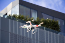 37208453 - radio controlled quadcopter drone flying in the city
