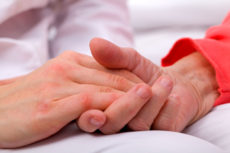 36914302 - caregiver holding elderly patients hand at home