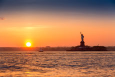 40299973 - statue of liberty at sunset as viewed from brooklyn new york