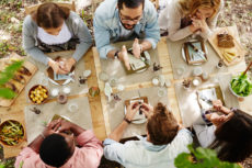 44666558 - group of young friends gathered at thanksgiving dinner table