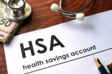 60527092 - paper with words weekly health savings account (hsa) on a table.