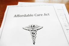 34499882 - affordable care act / obamacare document on a desk