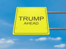 66047268 - yellow road sign trump ahead against a cloudy sky, 3d illustration