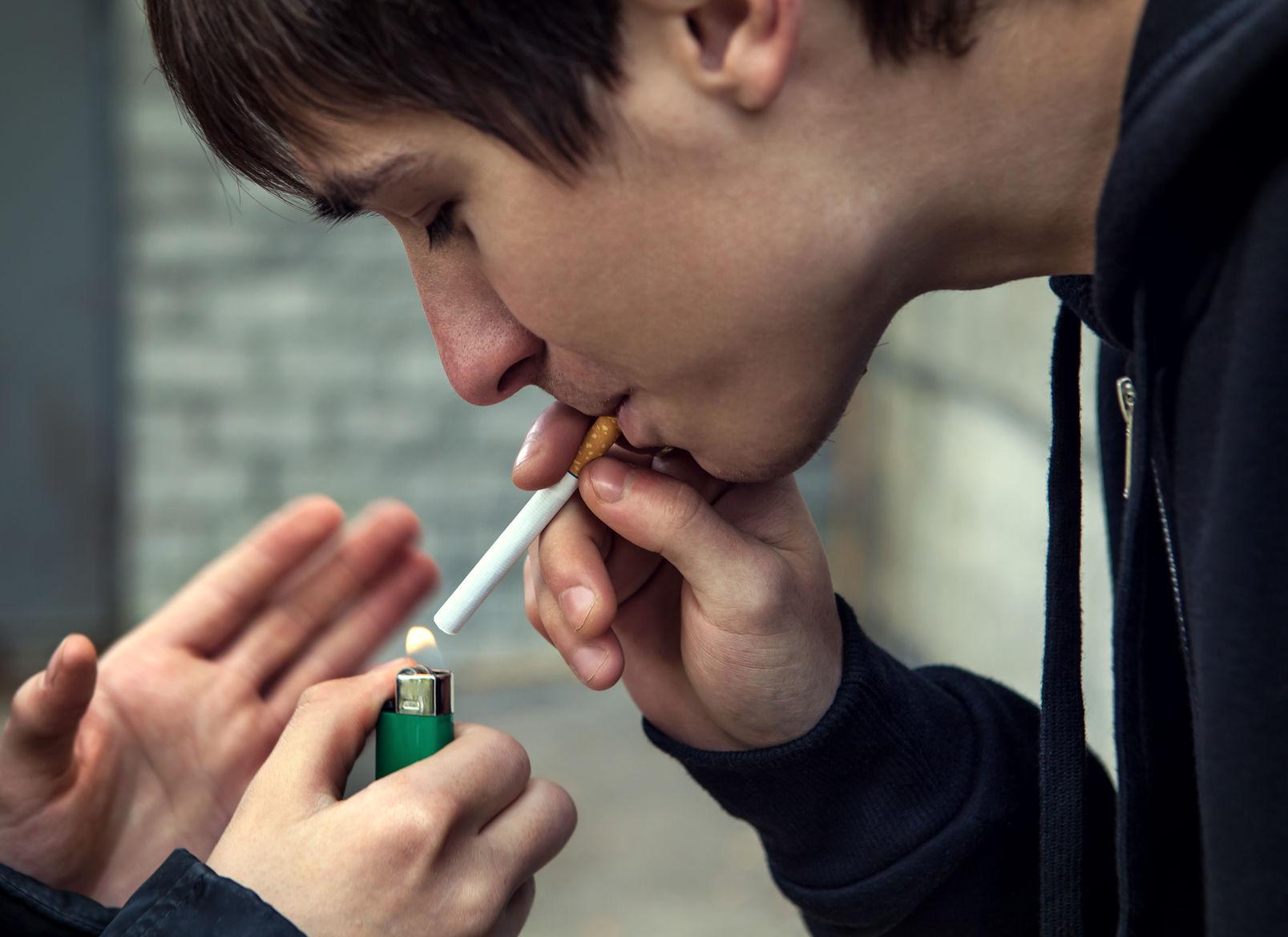 Teens cigarette smoking